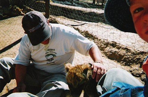 Tony stroking a hyena