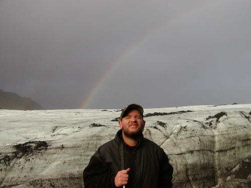 Tony at Myrdalsjokull glacier with rainbow in the background