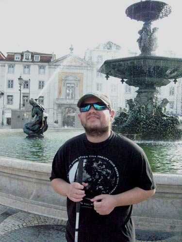 Tony in front of the Rossio Plaza fountain