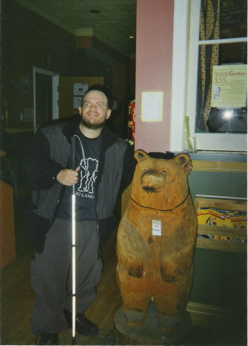 Tony with the bear at Canadiana Backpackers, Toronto