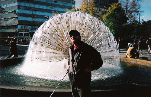 Tony in front of a fountain